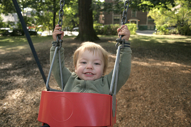 Spirited child on swing