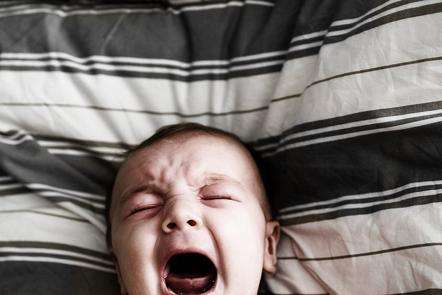 Baby crying in bed after applied kinesiology