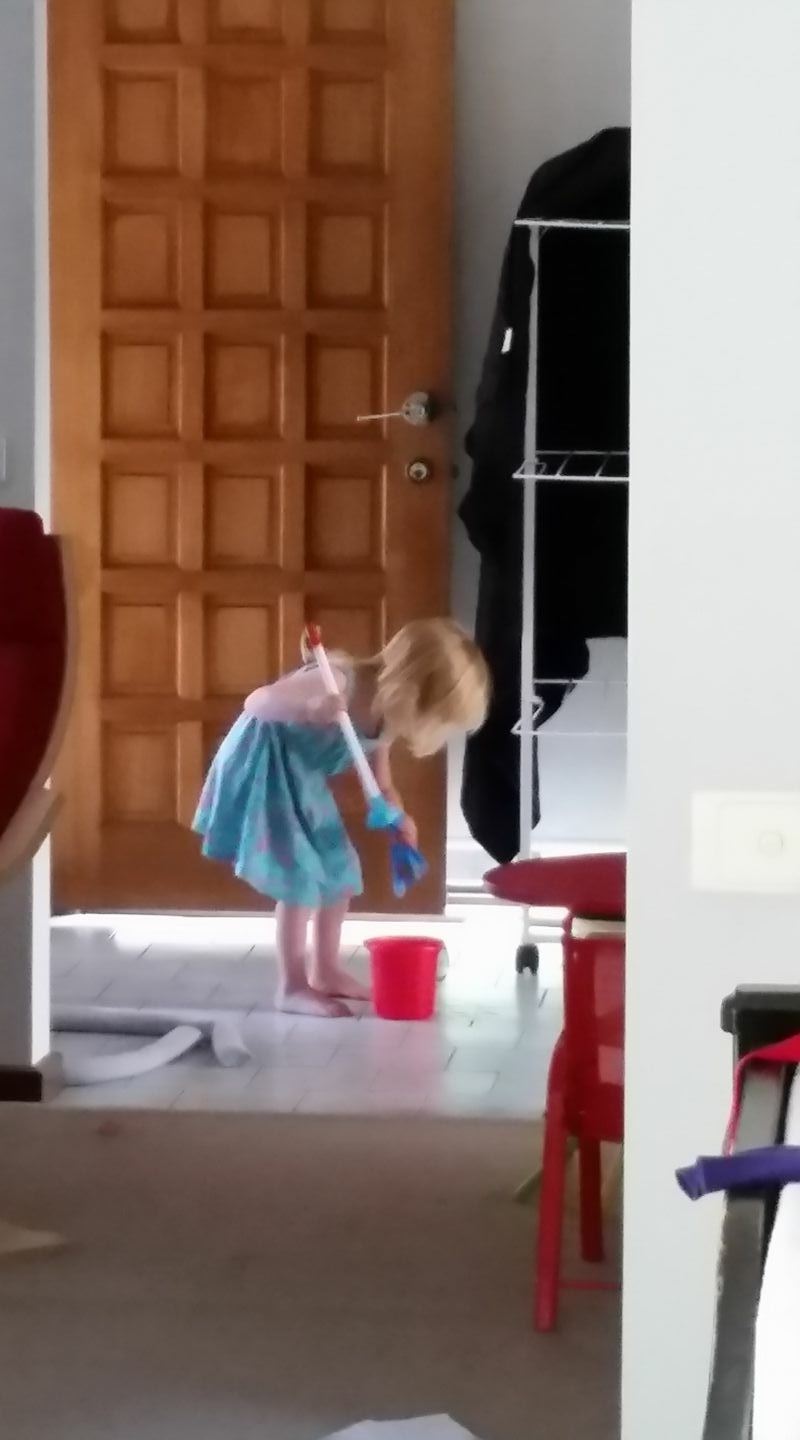 toddler with mini mop and bucket