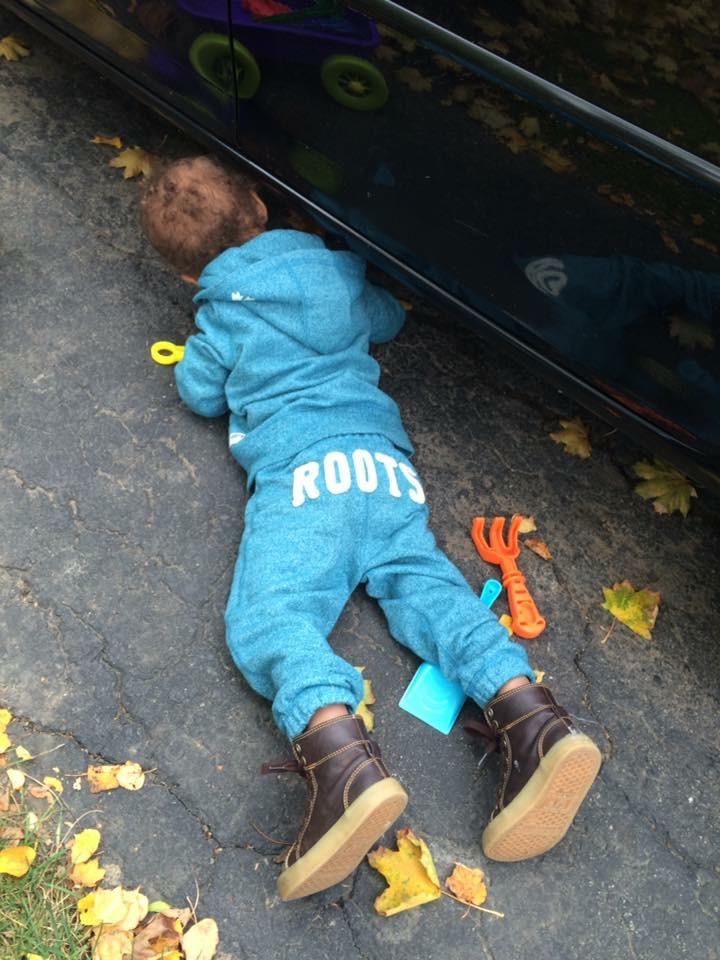 child helping fix car