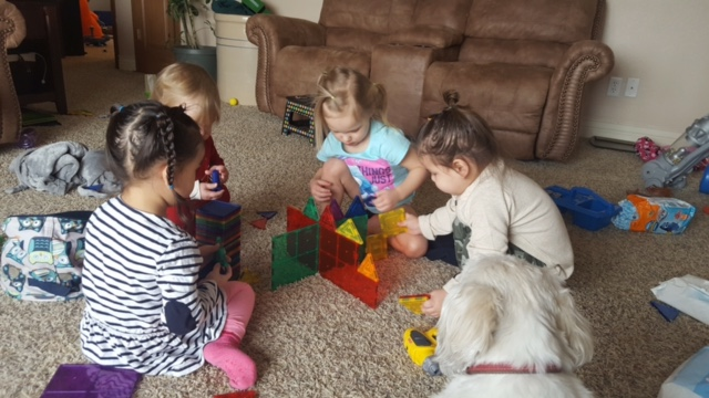 kids playing with magnatiles