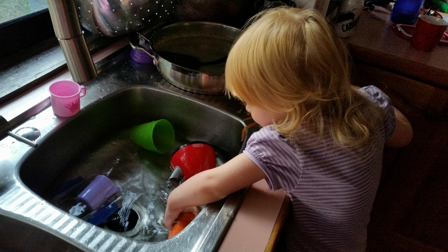 toddler helping with dishes